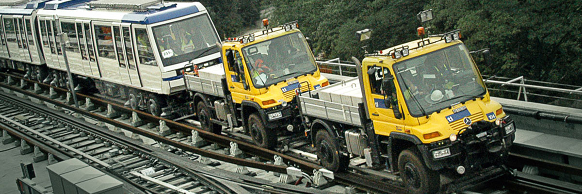 The Unimog's rubber road tyres operate on steel rails to generate high tractive and brake forces.